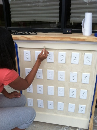 Everyl-Ann is putting the finishing touches on our Soy wax cube warmer display.